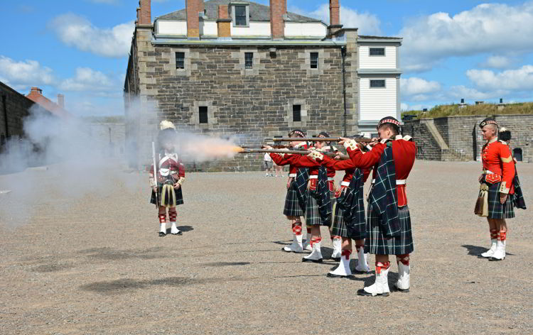 An image of soldiers firing rifles at Halifax Citadel National Historic Site in Halifax, Nova Scotia Canada - Halifax tours