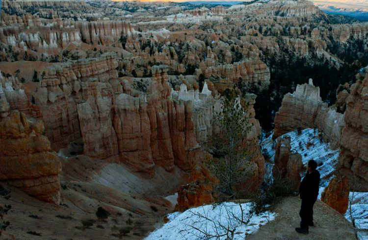 An image of Greg Olsen gazing out at the view from Sunset Point in Bryce Canyon National Park in Utah - best hikes in Bryce Canyon