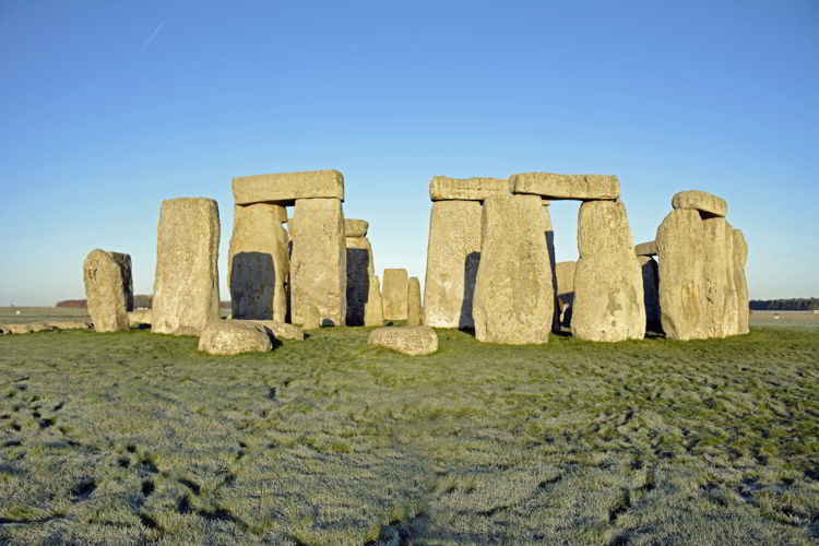 An image of Stonehenge bathed in morning light near Salisbury, UK - Stonehenge inner circle tours