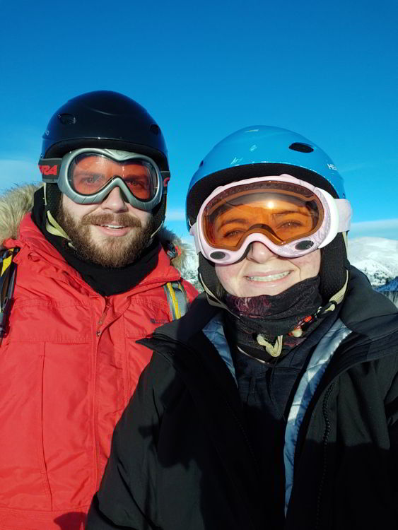 An image of two people in ski helmets and googles at Marmot Basin Ski Resort in Jasper - Jasper Skiing