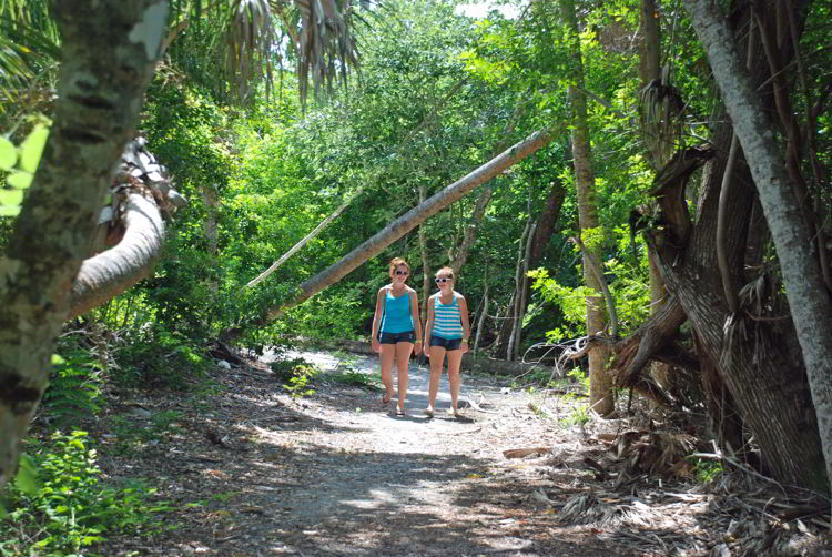 An image of two girls walking on the nature trail on Cabbage Key, Florida - Cabbage Key cheeseburger in paradise