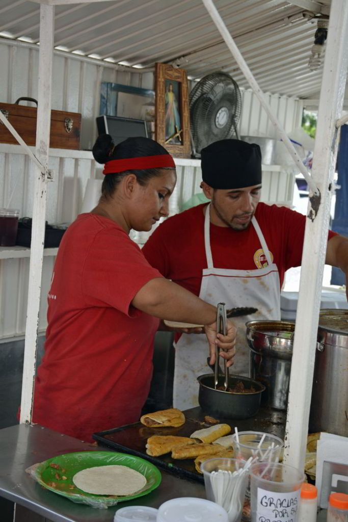 An image of two people working at the Tacos Robles taco stand in Puerto Vallarta, Mexico - the best tacos in Puerto Vallarta