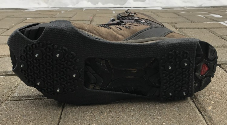 Image of the cleats on the GripOns ice cleat attached to a boot.