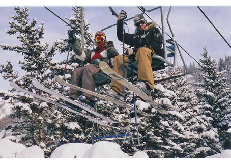 An image of two skiers riding a chairlift at Canyon Ski Resort in Red Deer - Things to do in Red Deer