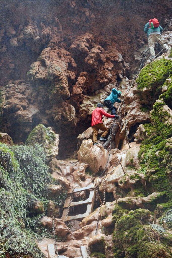 An image of hikers climbing down to Mooney Falls - Havasupai hike