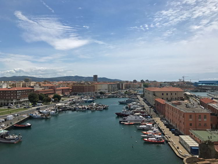 An image of boats focked in the Livorno cruise port in Livorno, Italy.