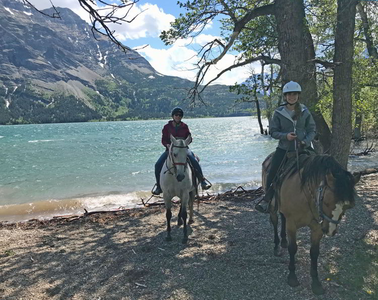 An image of two women horseback riding in Waterton Lakes National Park - Things to do in Waterton.