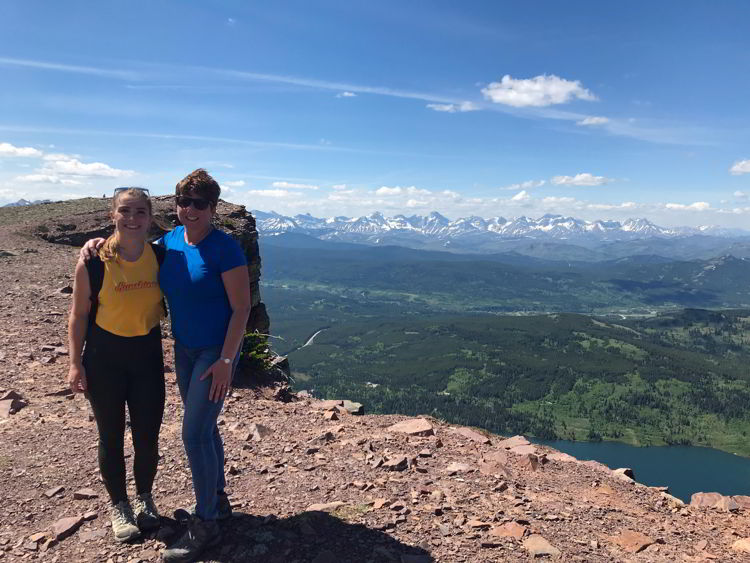 An image of two women standing at the top of Table Mountain in Alberta, Canada.