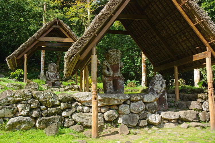 An image of the stone tikis on the island of Hiva Oa in the Marquesas Islands of French Polynesia - ass seen on an Aranui 5 cruise.