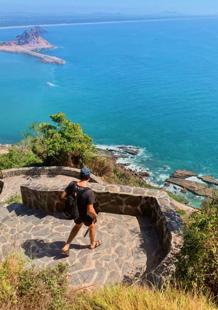 An image of a man taking in the views on the hike to El Faro Lighthouse in Mazatlan, Mexico.