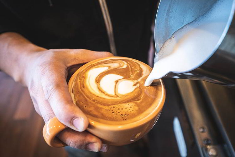 An image of someone pouring coffee.