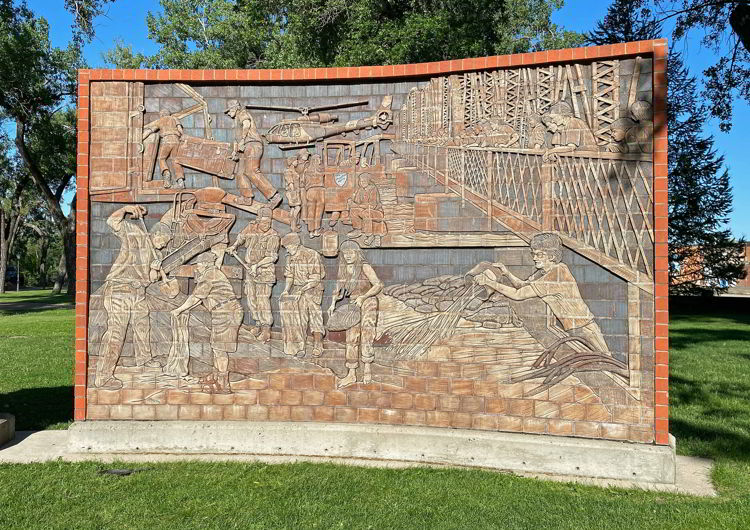 A historic stone mural depicting the 1995 flood in Medicine Hat, Alberta, Canada.