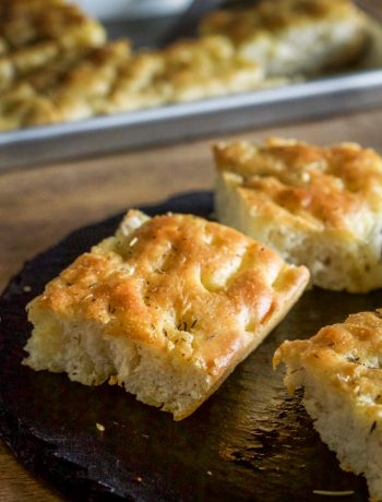 Focaccia made with olive oil infused rosemary, thyme and garlic. This bread will satisfy any craving for the Italian bread. | wanderzestblog.com