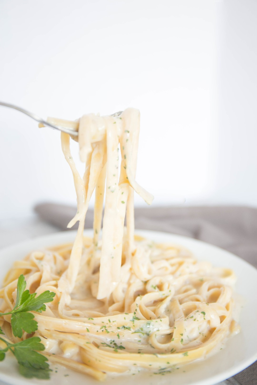 You don't need cream, parmesan or butter to make this Light Fettuccine Alfredo! It is just as good as the traditional sauce, yet has half the calories!