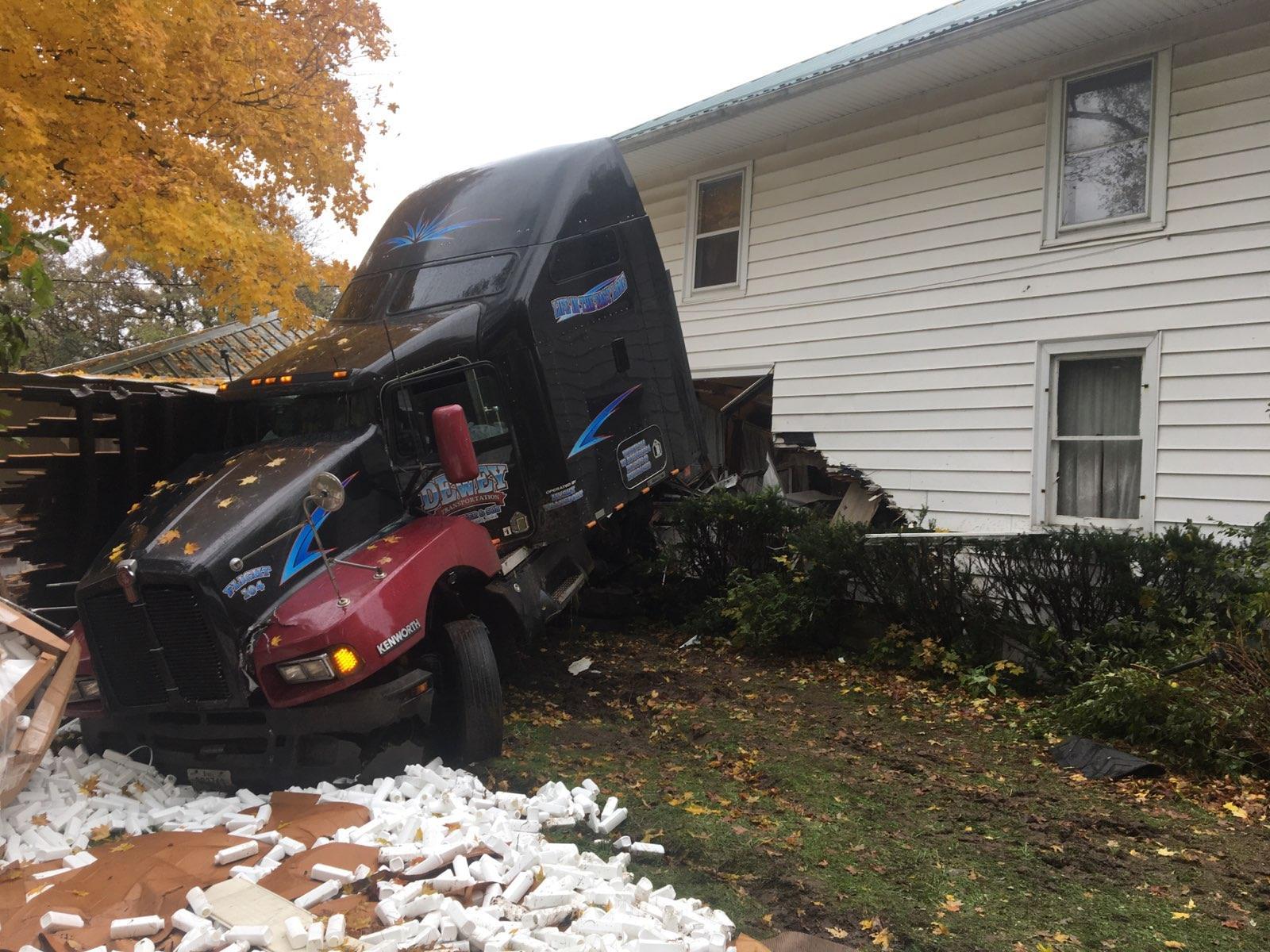 Crash cuts semi trailer in half, sends cab into home