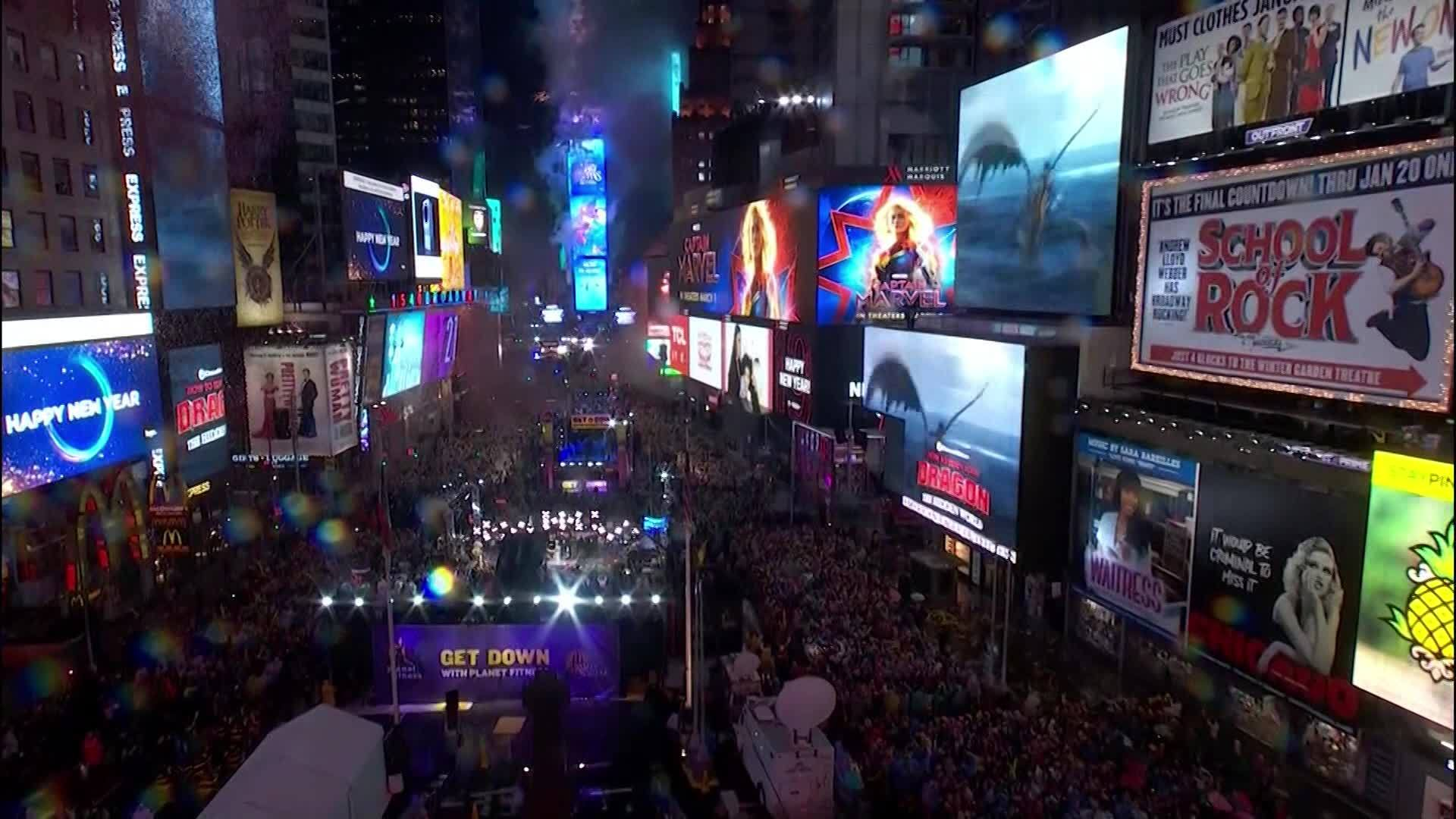 Times Square Crowd Braves Rain To Bid Wet Welcome To