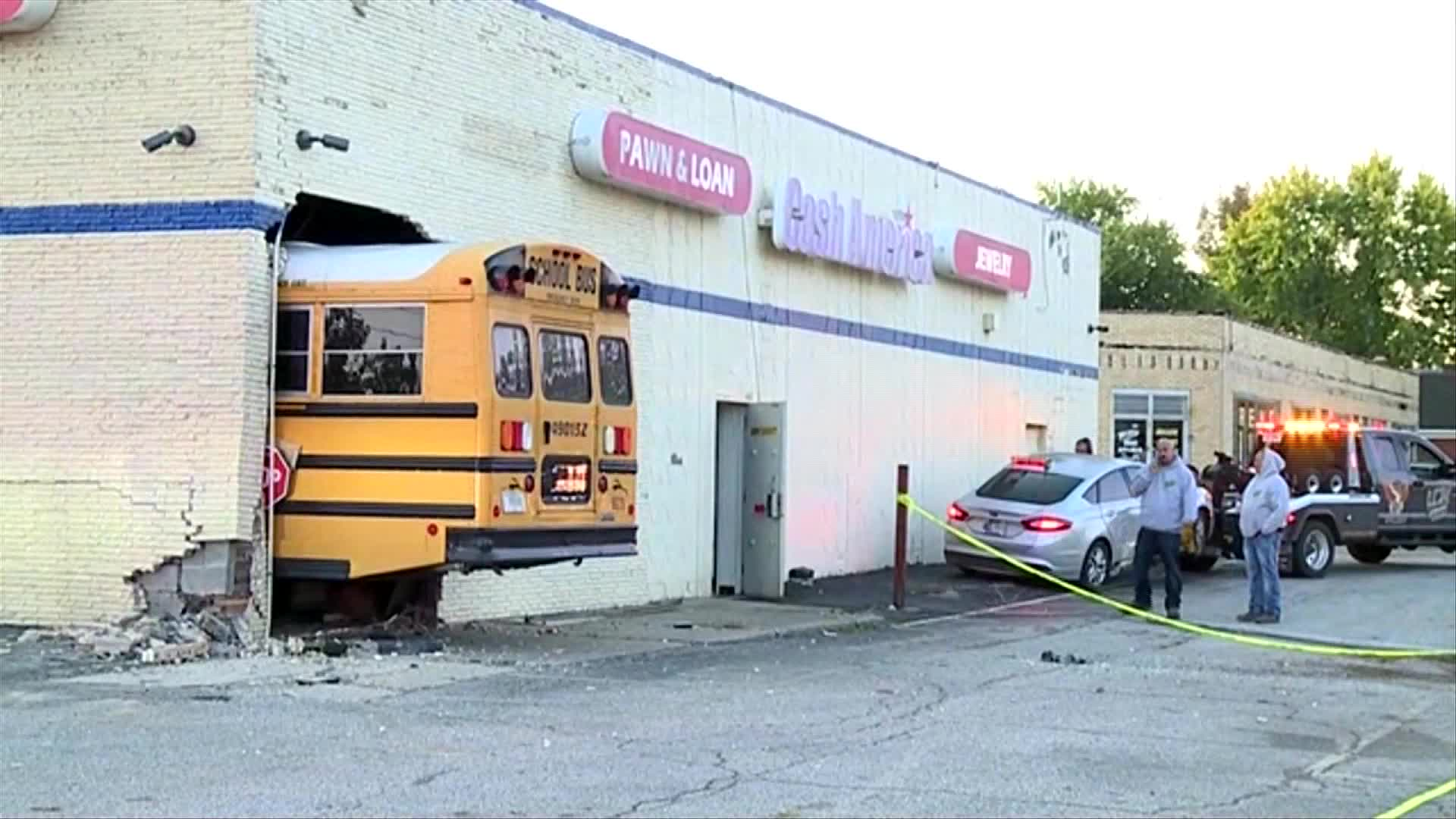 bus crashes into building