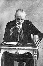 De Fransman André Bovis, met pendel boven zijn zelf ontwikkelde schaalverdeling. De Bovis-schaal.