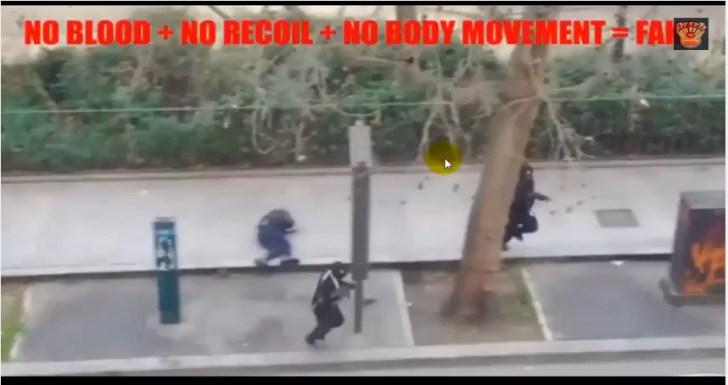 Een gruwelijk beeld of een bewijs van 'fake'..?? De op de grond liggende agent, zou zojuist door het hoofd geschoten zijn met een Kalashnikov-machinegeweer.  De 'dader' loopt achter de boom weg.. Het is een paar seconden ná het 'hoofdschot', dat op de agent afgevuurd werd. Maarr.. Waar is het bloed, waar was de 'reactie' van het lichaam van de agent, bij de impact van het schot..?!