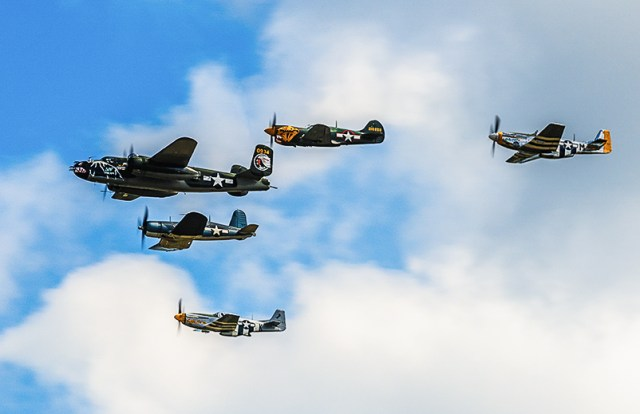 The Texas Flying Legends Museum Vic on it's initial flypast over AirVenture. (photo by Jake Peterson)