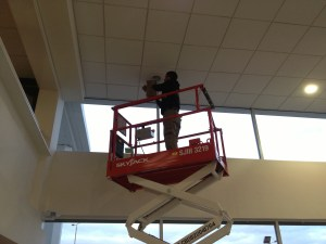 working off a platform replacing blown lamps as part of our maintenance contracts