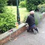 John preparing the lamp post for switch on