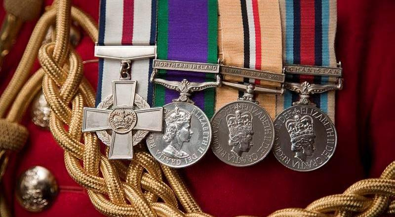 British Army, Life Guards, A Corporal of Horse (CoH) proudly displays his medals by Harland Quarrington (Crown Copyright, 2011) News Licence
