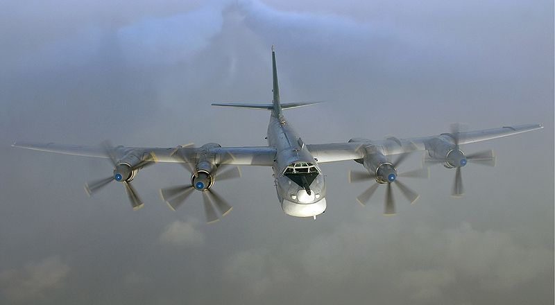 Russian Air Force Tupolev TU-95MS strategic bomber flying over Russia, 2007, by Sergey Krivchikov, Russian AviaPhoto Team (CC)