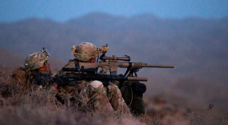 US Army snipers using the M110 semi-automatice sniper system (FDE rifle) and the new M2010 bolt-action sniper rifle chambered for 300 WinMag (US Army)