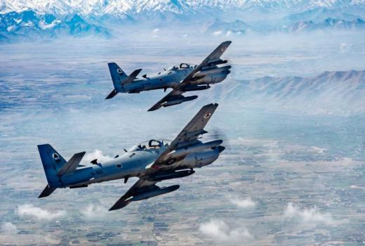 USAF two A-29 Super Tucano fighter-bombers over Afghanistan, 23 March 2017, by Jordan Castelan (USAF)