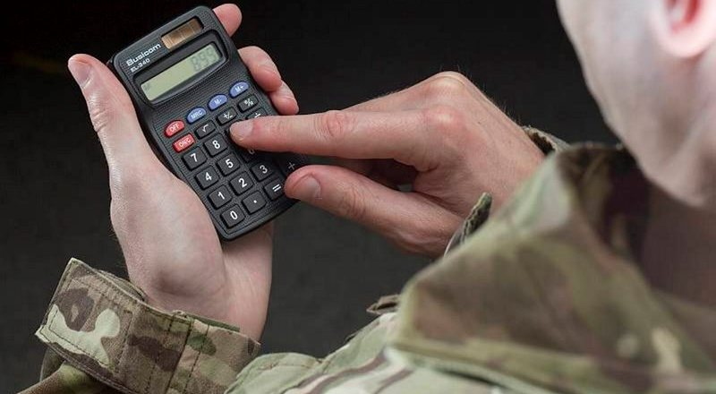 British Army, soldier using a calculator by Harland Quarrington (Crown Copyright, 2014)