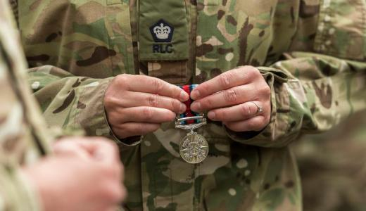 British Army, 7 Regiment, Royal Logistic Corps, a soldier holds his Afghanistan Medal following a parade at Bielefeld, Germany (Crown Copyright, 2013)