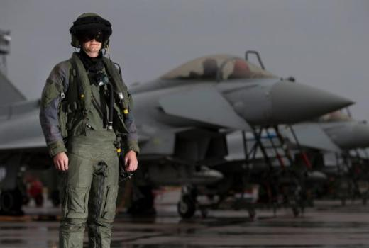 RAF, 6 Squadron, RAF Losseimouth, pilot stands in front of a line of Typhoon aircraft in full flying attire (Crown Copyright, 2016)