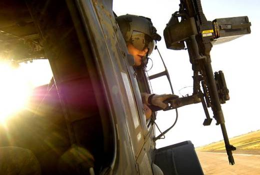US Army Pfc Jordan Williams, UH-60 Blackhawk crew chief for B Co, 1-207th AVN, Alaska National Guard, near Tall Afar, Iraq, on June 5, 2006, by Staff Sgt Jacob N Baile
