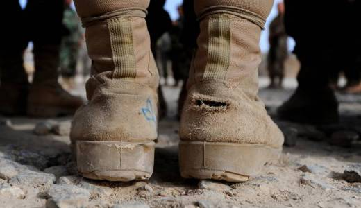 Afghan National Army (ANA), soldier with worn-out boots stands to attention by Kenny Holston (CC2)