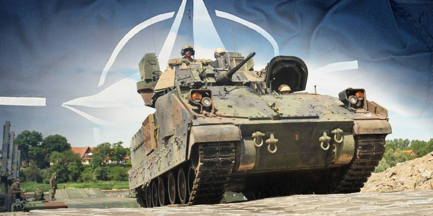 NATO flag with US Army M2A3 Bradley crossing River Elbe with German M3s, 2015