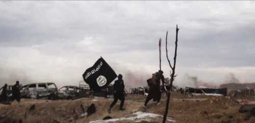 ISIS last stand in Baghuz, Syria, fighters with flag (via ISIS Amaq) [500]