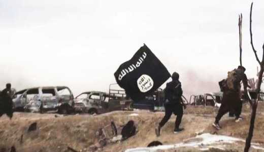 ISIS propaganda image from Baghuz, Syria, fighters with black flag (via ISIS Amaq)