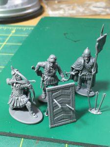 Troops hide behind a Spara shield