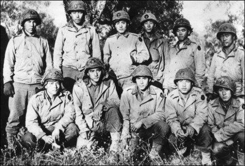 "Members of the ""Lost Battalion"" posing with some of the 442nd"