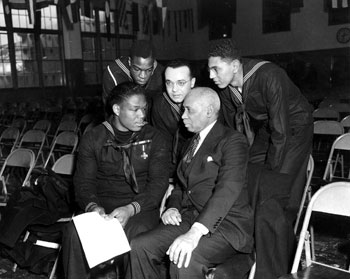 Miller speaking with sailors and a civilian at Naval Station Great Lakes, January 7, 1943.