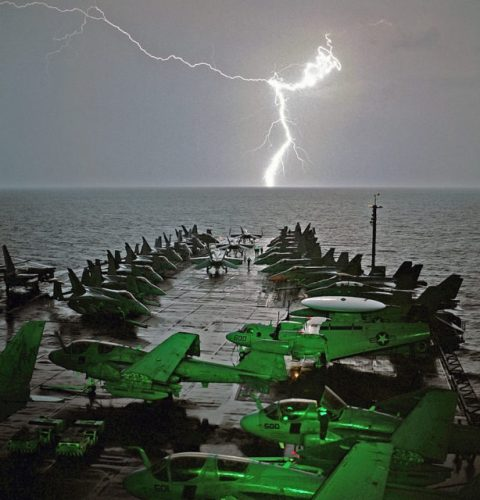 Lightning strikes in the horizon as Abraham Lincoln sails in the Arabian Sea.