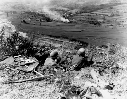 Troops of the U.S. 27th Infantry await North Korean attacks across the Naktong River from positions on the Pusan Perimeter, September 4, 1950.