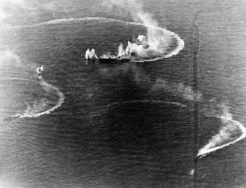 The carrier Zuikaku (center) and two destroyers under attack by U.S. Navy carrier aircraft, June 20, 1944