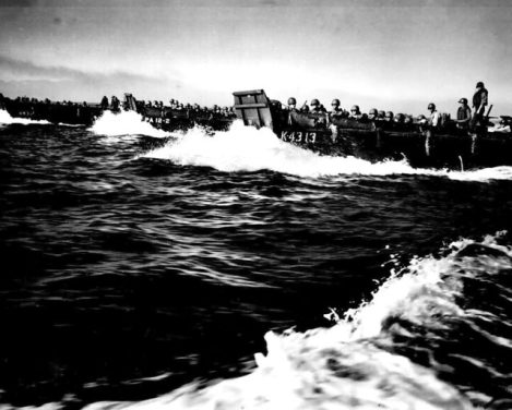 Coast Guard manned landing craft rush towards the shore, packed with US Army infantry. They're about to retake the Philippines. Image Source: Wikimedia Commons/ Public Domain