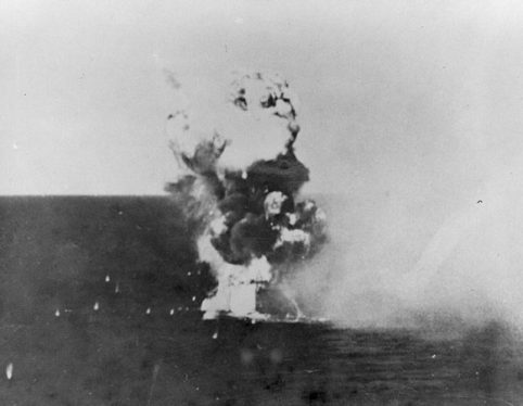 USS Columbia is engulfed in flames as a kamikaze hits. Image Source: Wikimedia Commons/ Public Domain