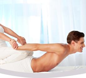 Massage therapist doing Thai massage