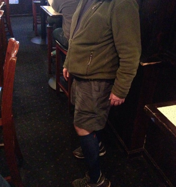 Pub crawler in shorts and compression socks