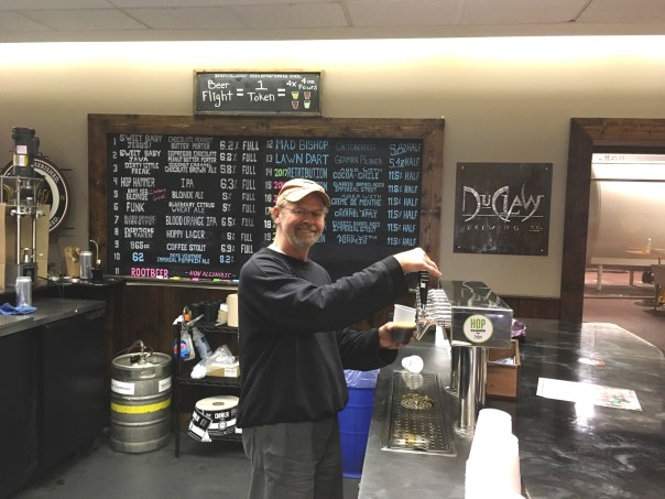 Stephen Demczuk pours beer at DuClaw
