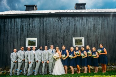 Wedding Party in gray and navy in front of Kentucky barn